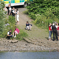 Tay River Accident...13.7.2005.<br /> Police talk to teenagers at the scene.  Believed to be friends of the victim.<br /> (Please see Gordon Currie story 01738 446766).<br /> <br /> NO BYLINE TO BE USED WITH IMAGE.<br /> Picture by John Lindsay<br /> COPYRIGHT: Perthshire Picture Agency.<br /> Tel. 01738 623350 / 07775 852112.