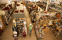 Doug Petelle of Northfield walks through Laconia Antique Center.  (Karen Bobotas/for the Laconia Daily Sun)