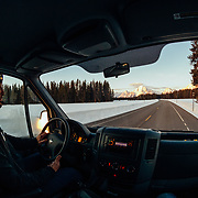 Andrew McCarthy drives towards Yellowstone at sunrise.