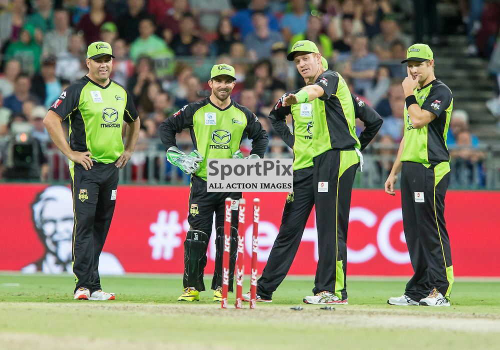 KFC Big Bash League T20 2015-16 , Sydney Thunder v Perth Scorchers, Spotless Stadium; 7 January 2016<br /> Sydney Thunder players around the stumps after Perth Scorchers Ashton Agar is run out by Sydney Thunder Chris Hartley