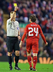 LIVERPOOL, ENGLAND - Wednesday, October 28, 2015: Liverpool's Joe Allen is shown a yellow card by referee Mike Jones after a foul on Wales international team-mate AFC Bournemouth's Shaun MacDonald during the Football League Cup 4th Round match at Anfield. (Pic by David Rawcliffe/Propaganda)