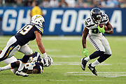 Seattle Seahawks rookie wide receiver David Moore (83) makes a cut while being chased by Los Angeles Chargers linebacker James Onwualu (49) during the 2017 NFL week 1 preseason football game against the against the Los Angeles Chargers, Sunday, Aug. 13, 2017 in Carson, Calif. The Seahawks won the game 48-17. (©Paul Anthony Spinelli)