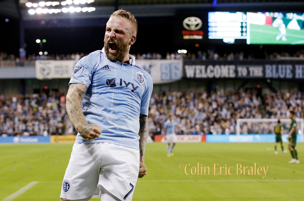 Sporting Kansas City forward Johnny Russell (7) celebrates scoring a goal during the second half of a MLS soccer match in Kansas City, Kan., Saturday, Aug. 18, 2018. Sporting KC beat the Timbers 3-0. (AP Photo/Colin E. Braley)
