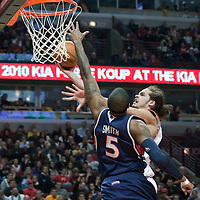 19 December 2009: Chicago Bulls center Joakim Noah goes to the basket against Atlanta Hawks forward Josh Smith during the Chicago Bulls 101-98 victory in overtime over the Atlanta Hawks at the United Center, in Chicago, Illinois, USA.