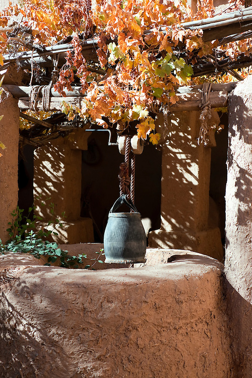 Well with water bucket inside the kasbah Amridil, Skoua.