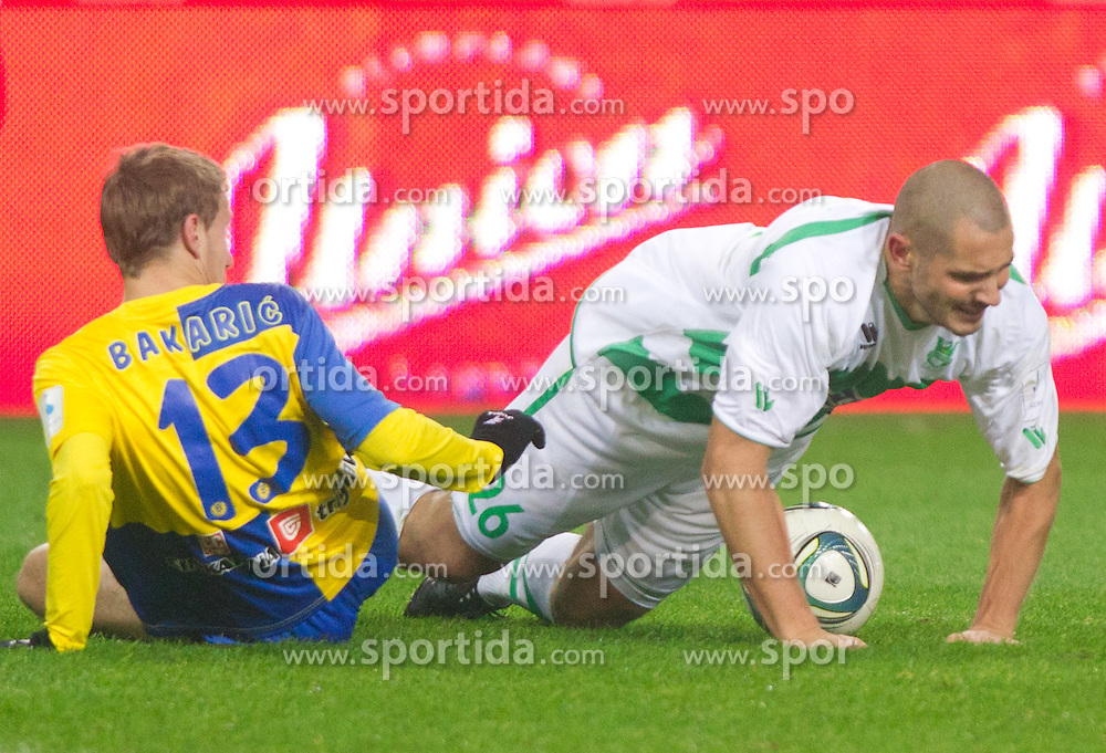 Sasa Bakaric of Celje vs Sreten Sretenovic of Olimpija during football match between NK Olimpija Ljubljana and CM Celje of 19th Round of PrvaLiga 2011/2012, on November 23, 2011 in SRC Stozice, Ljubljana, Slovenia.  (Photo By Vid Ponikvar / Sportida.com)