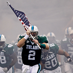 Sep 11, 2010; New Orleans, LA, USA; Tulane Green Wave quarterback Kevin Moore (2) runs onto the field with an American flag prior to kickoff of a game between the Mississippi Rebels and Tulane Green Wave at the Louisiana Superdome.  Mandatory Credit: Derick E. Hingle