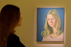 """© Licensed to London News Pictures. 25/04/2017. London, UK. A staff member views """"Ohne Titel (Roswitha Avalon), (Untitled (Roswitha Avalon)"""", 1971, by Maria Lassnig.  Launch of a new exhibition program at Sotheby's S