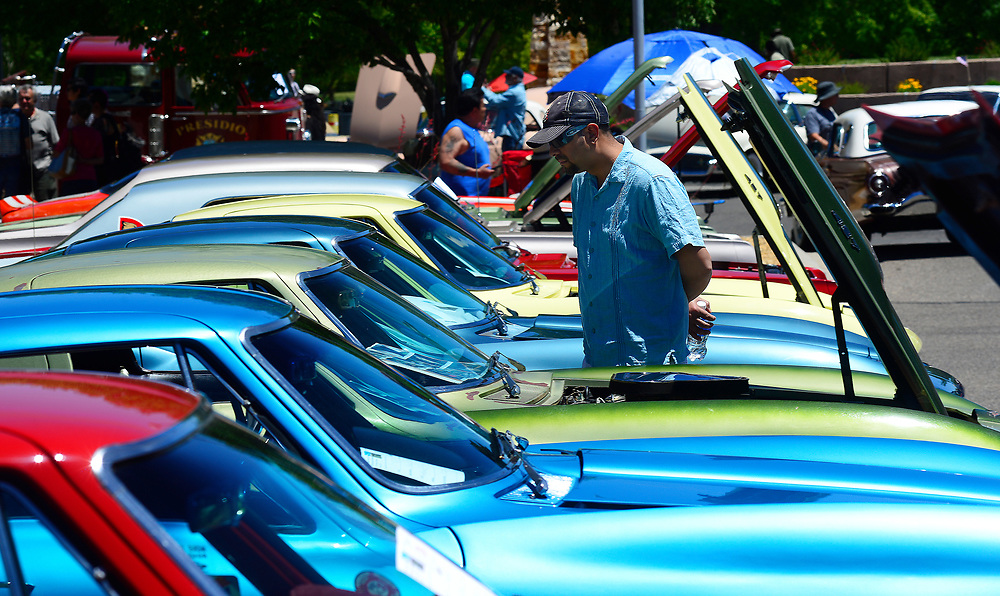 apl052117b/ASECTION/pierre-louis/JOURNAL 052117<br /> Dennis Trujeque,, checks out the classic Corvettes  on display at the 33rd Annual  NMCCC Classic  Auto Show held in Old Town.&quot;I've been in love with these cars since I was 10 year-old &quot; says Trujeque who owns a 2000 Corvette.  Photographed on Sunday May 21,  2017. .Adolphe Pierre-Louis/JOURNAL
