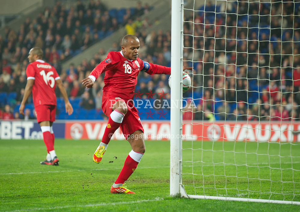 CARDIFF, WALES - Wednesday, February 29, 2012: Wales' Robert Earnshaw scores against Costa Rica, but the goal is disallowed, during the international friendly match at the Cardiff City Stadium. (Pic by David Rawcliffe/Propaganda)