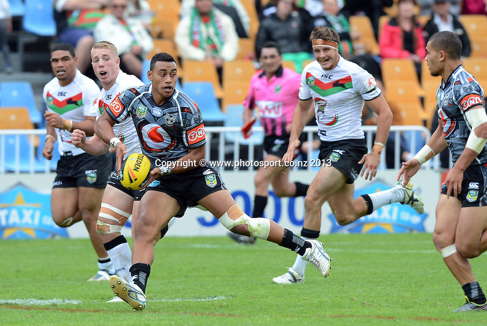 Junior fullback Ngataua Hukatai looks to pass. Holden Cup Rugby League match, Vodafone Junior Warriors v Junior Rabbitohs at Mt Smart Stadium, Auckland, New Zealand on Sunday 7 April 2013. Photo: Andrew Cornaga/Photosport.co.nz