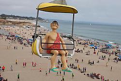 A caveman statue rides above the beach, Santa Cruz Boardwalk, Santa Cruz, California, United States of America