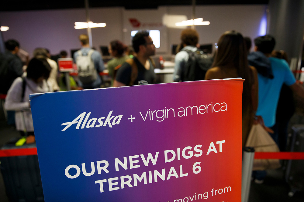 Signage from Alaska Airlines and Virgin America advises customers of the shift from Terminal 3 to Terminal 6 as the airline relocation begins at Los Angles International Airport (LAX) on Friday, May 12, 2017 in Los Angeles, Calif. Delta Airlines will move from Terminals 5 and 6 to Terminals 2 and 3, forcing 19 other carriers to shift their operations into the facilities vacated by Delta.  © 2017 Patrick T. Fallon
