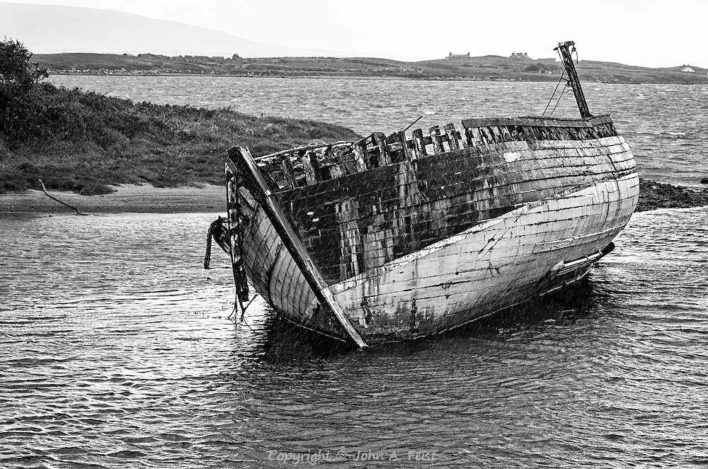We were driving along the coast road in Co Sligo, Ireland when we spotted this shipwreck.  I don't know any more about this ship.  This is my favorite rendering of this image.  The black and white format adds a timeless feel and a touch of the heartbreak that this is how the ship ended up.