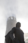 statue and Coit Tower in fog, San Francisco