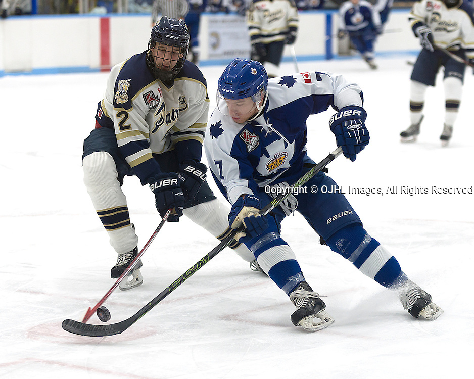MARKHAM, ON - OCT 21,  2016: Ontario Junior Hockey League game between the Markham Royals and the Toronto Patriots, Douglas Carter #7 of the Markham Royals battle for the puck with Travis Mailhot #2 of the Toronto Patriots during the first period.<br /> (Photo by Mike DiCarlo / OJHL Images)