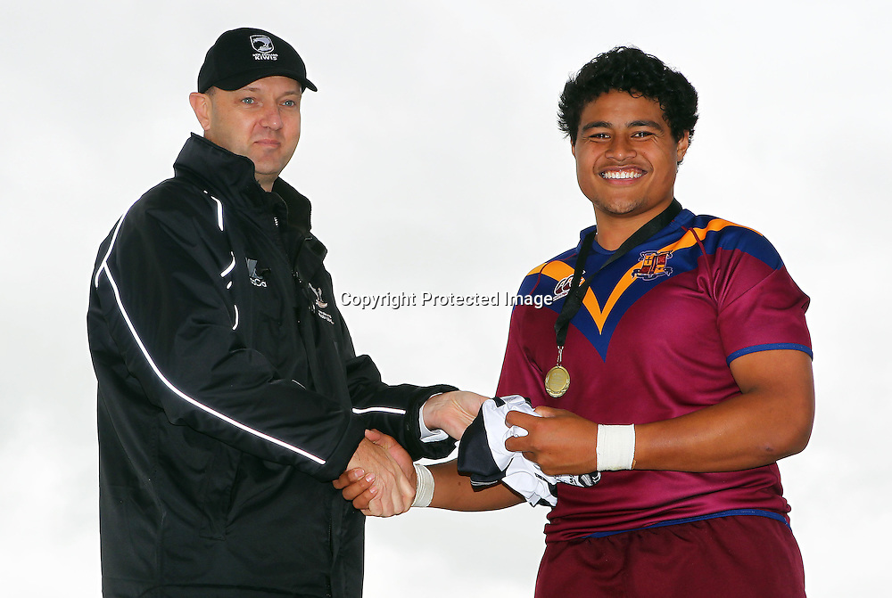 NZRL Chairman Scott Carter presents the Jim doyle player of the day award to Toafofoa Sipley of St Pauls. New Zealand Secondary Schools National Rugby League Tournament, Grand Final, Otahuhu v St Pauls. Bruce Pulman Park, Auckland. 7 September 2012. Photo: William Booth/photosport.co.nz