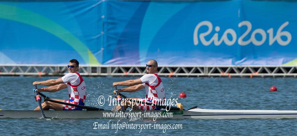 Rio de Janeiro. BRAZIL.  Gold  Medalist CRO M2X. . Bow. Martin SINKOVIC and Valent<br /> SINKOVIC,  2016 Olympic Rowing Regatta. Lagoa Stadium,<br /> Copacabana,  &ldquo;Olympic Summer Games&rdquo;<br /> Rodrigo de Freitas Lagoon, Lagoa. Local Time 11:35:45  Thursday  11/08/2016 <br /> [Mandatory Credit; Peter SPURRIER/Intersport Images]