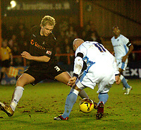 Photo: Ian Hebden.<br /> <br /> Barnet FC v Wycombe Wanderers. Coca Cola League 2. 21/01/2006.<br /> <br /> Barnts Clint Easton (L) tackles Wycombes Tom Mooney (L).