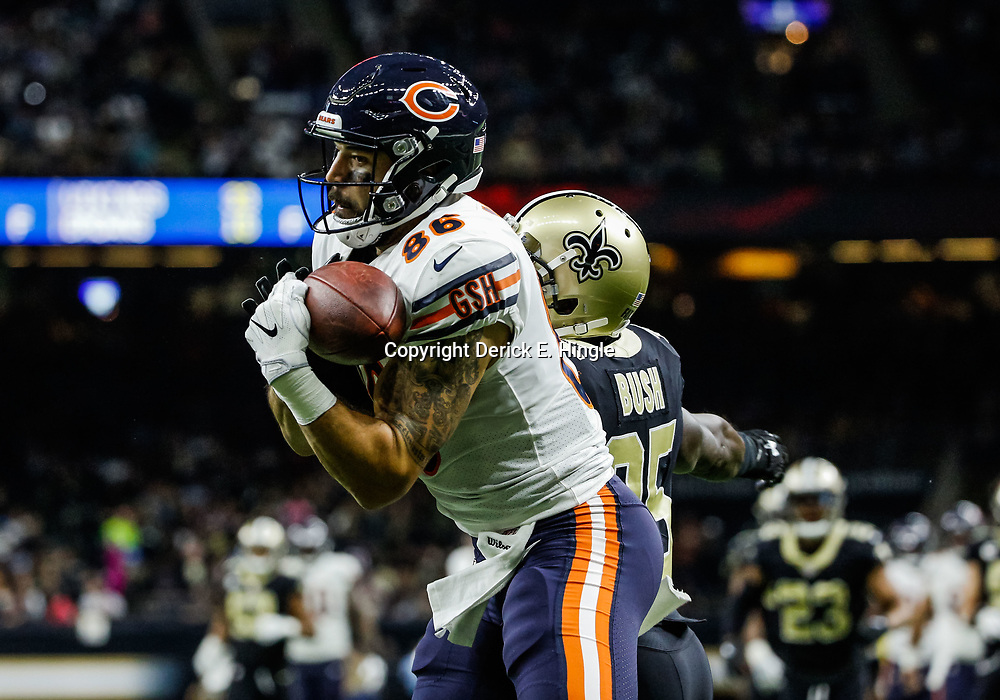 Oct 29, 2017; New Orleans, LA, USA; Chicago Bears tight end Zach Miller (86) is defended by New Orleans Saints safety Rafael Bush (25) on a play in the endzone. Miller was injured on the play and after a review the ruling of a touchdown catch was overturned during the second half of a game at the Mercedes-Benz Superdome. The Saints defeated the Bears 20-12. Mandatory Credit: Derick E. Hingle-USA TODAY Sports