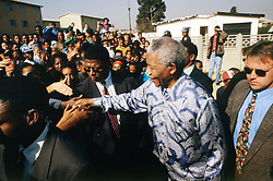 NELSON ROLIHLAHLA MANDELA (July 18, 1918 - December 5, 2013), 95, world renown civil rights activist and world leader. Mandela emerged from prison to become the first black President of South Africa in 1994. As a symbol of peacemaking, he won the 1993 Nobel Peace Prize. Joined his countries anti-apartheid movement in his 20s and then the ANC (African National Congress) in 1942. For next 20 years, he directed a campaign of peaceful, non-violent defiance against the South African government and its racist policies and for his efforts was incarcerated for 27 years. Remained strong and faithful to his cause, thru out his life, of a world of peace. Transforming the world, to make it a better place. PICTURED: 1994 -South Africa - NELSON MANDELA, during his campaign tour leading up to the 1994 elections.   (Credit Image: © Greg Marinovich/ZUMA Wire/ZUMAPRESS.com)