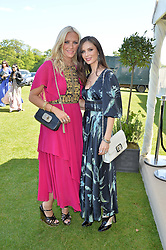 Left to right, KAREN CRAIG and GEORGINA CHAPMAN at the St.Regis International Polo Cup at Cowdray Park, Midhurst, West Sussex on 16th May 2015.