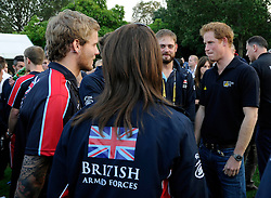 His Royal Highness, Prince Harry speaks with members from the Great British team at the Winfield Reception - Photo mandatory by-line: Joe Meredith/JMP - Mobile: 07966 386802 - 9/09/14 - Winfield reception for the Invictus Games - London - Winfield House