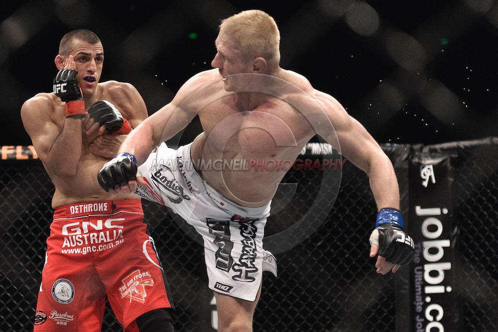 "SYDNEY, AUSTRALIA, FEBRUARY 27, 2011: George Sotiropoulos (facing) is hit by a spinning back kick from Dennis Siver during ""UFC 127: Penn vs. Fitch"" inside Acer Arena in Sydney, Australia on February 27, 2011."