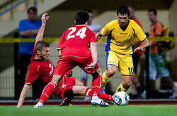 Igor Budisa and Ante Erceg of Split vs Mario Lucas Horvat of Domzale. UEFA Europa League, Second Qualifying Round, 1st Leg, NK Domzale vs RNK Split, on July 14, 2011, in Sports park Domzale, Slovenia. (Photo by Vid Ponikvar / Sportida)