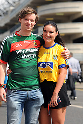 A love divided Brian Reilly from Balla and Rosiin McManus from Roscommon<br /> on their way to the Croke park for the All Ireland quarter final replay<br /> Pic Conor McKeown