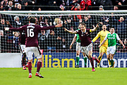 Christophe Berra (#6) of Heart of Midlothian celebrates Heart of Midlothian's first goal (1-0) scored by Don Cowie (#15) of Heart of Midlothian during the William Hill Scottish Cup 4th round match between Heart of Midlothian and Hibernian at Tynecastle Stadium, Gorgie, Scotland on 21 January 2018. Photo by Craig Doyle.