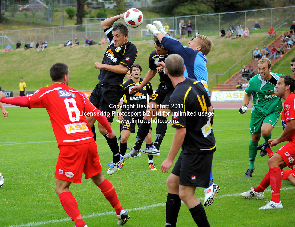 Wellington's Wiremu Patrick goes up for a last-minute header with his forearm raised as Waitakere keeper Danny Robinson punches the ball away. ASB Premiership soccer  - Team Wellington v Waitakere United at Newtown Park, Wellington, New Zealand on Saturday, 22 January 2011. Photo: Dave Lintott / photosport.co.nz