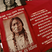 "Protest Tee Shirt with a message ""Broken Promises Sure you can trust the Government. Just Ask an Indian"" on sale at pow wow. Old photography of Sitting Bull"
