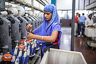 Raw cotton being processed into yarn and thread in the Spinning Room of the Pratibha vertically integrated garment unit in Indore, Madhya Pradesh, India on 11 November 2014. Photo by Suzanne Lee for Fairtrade