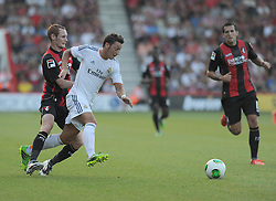 Bournemouth's Shaun Macdonald fouls Real Madrid's Mesut Ozil from behind  - Photo mandatory by-line: Alex James/JMP  - Tel: Mobile:07966 386802 20/07/2013 -Bournemouth vs Real Madrid  - SPORT - FOOTBALL -  Dean Court-Bournemouth - Real Madrid -