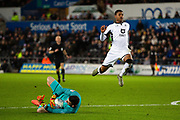 Swansea City forward Rhian Brewster (19) jumps over Queens Park Rangers goalkeeper Liam Kelly (32)  during the EFL Sky Bet Championship match between Swansea City and Queens Park Rangers at the Liberty Stadium, Swansea, Wales on 11 February 2020.