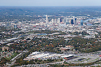 Aerial photo of the Nashville Skyline showing the fairgrounds with an ongoing flea market in the foreground.