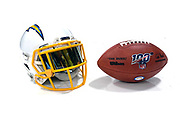 Jun 13, 2019; Costa Mesa, CA, USA; General overall view of  Los Angeles Chargers helmet and 100th NFL anniversary logo ball during minicamp at the Hoag Performance Center.