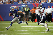 New York Giants kicker Josh Brown (3) runs from Houston Texans cornerback Kareem Jackson (25) after recovering a loose ball on a bad snap during a failed field goal attempt in the second quarter during the NFL week 3 regular season football game against the Houston Texans on Sunday, Sept. 21, 2014 in East Rutherford, N.J. The Giants won the game 30-17. ©Paul Anthony Spinelli