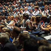 Attendees applaud during a panel discussion about the Stratos project in the IMAX Theater at The Smithsonian National Air and Space Museum in Washington, D.C., USA on 1 April, 2014.