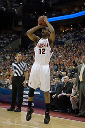 Virginia Cavaliers forward Jamil Tucker (12)  shoots a first half three pointer against Tennessee.  The #4 seed Virginia Cavaliers were defeated by the #5 seed Tennessee Volunteers 77-74 in the second round of the Men's NCAA Tournament in Columbus, OH on March 18, 2007.