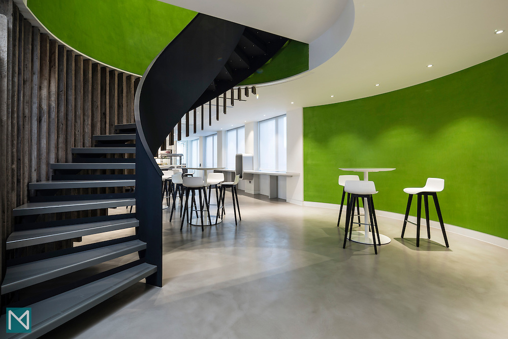 Interior of the office of SEB in London showing the canteen area and a spiral staircase, for Burtt-Jones and Brewer