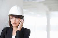 Business woman on mobile phone in empty warehouse