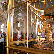 Catherine II acquired the Golden Peacock Clock in 1781 from England. The automaton clock has several moving parts including a peacock, a cockerel or rooster, an owl, a mushroom and a squirrel is on display at the Hermitage Museum.<br /> Photography by Jose More