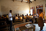 A school girl presents from the front of her classroom at Tonga Junior High School, Ghana.