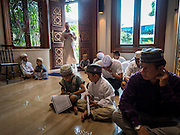 17 JULY 2015 - BANGKOK, THAILAND:     A man walks into the main prayer room for Eid services at Ton Son Mosque in Bangkok. Eid al-Fitr is also called Feast of Breaking the Fast, the Sugar Feast, Bayram (Bajram), the Sweet Festival or Hari Raya Puasa and the Lesser Eid. It is an important Muslim religious holiday that marks the end of Ramadan, the Islamic holy month of fasting. Muslims are not allowed to fast on Eid. The holiday celebrates the conclusion of the 29 or 30 days of dawn-to-sunset fasting Muslims do during the month of Ramadan. Islam is the second largest religion in Thailand. Government sources say about 5% of Thais are Muslim, many in the Muslim community say the number is closer to 10%.          PHOTO BY JACK KURTZ