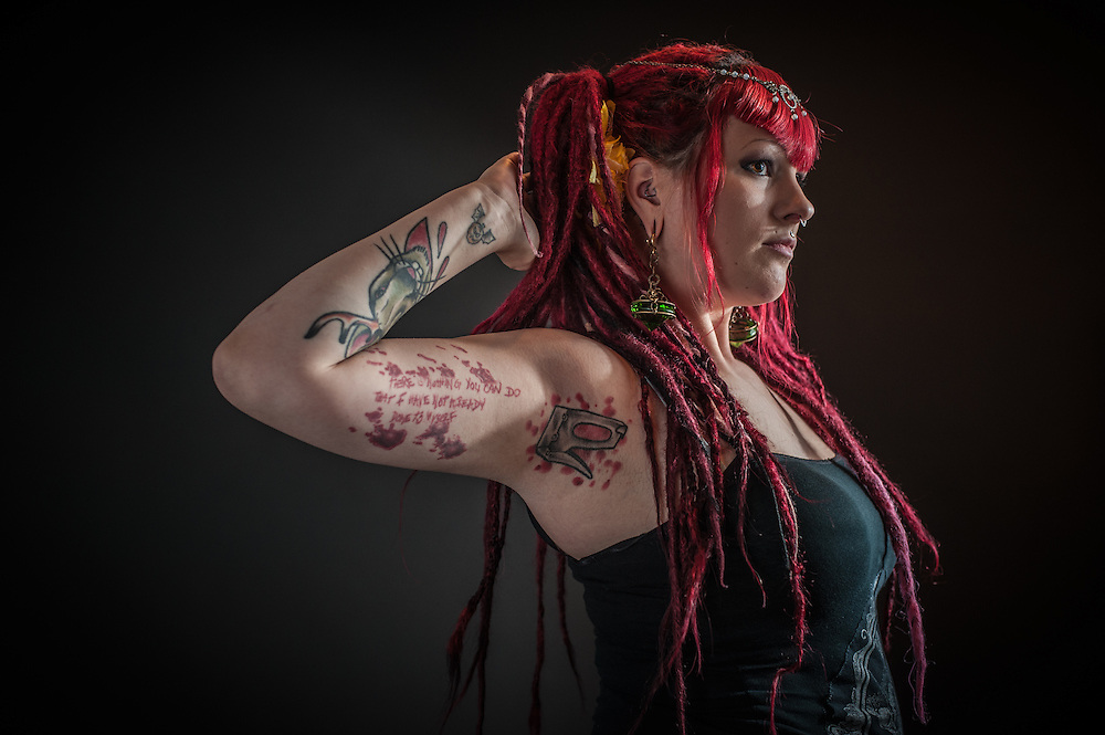 """WASHINGTON, DC -- OCTOBER 3: Sabrina Elliotte, 24, of Rockville. """"My favorite tattoo is in my armpit. I used to work for sideshows and they used to staple money to me. People used to staple it in my armpits, and on my face and everywhere. I just thought it would be funny to get a staple gun in my armpit.  For me, [pain] is just a mental thing. I like to know that I can get over it on my own. It's empowering to know that I can make myself calm and centered and I can handle it and that it will be okay, it's only temporary."""""""
