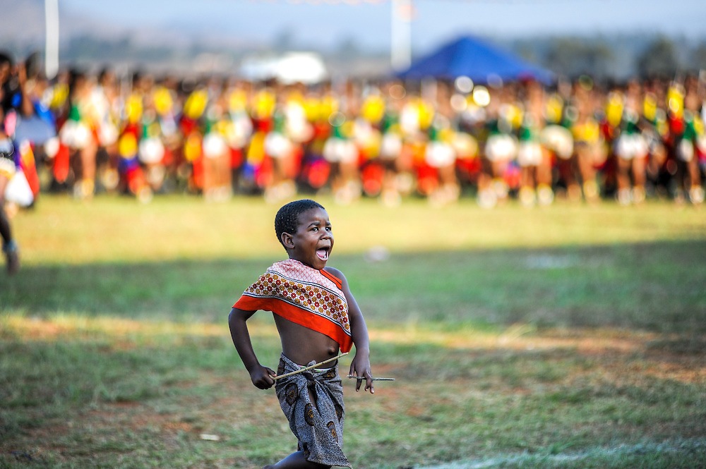 Ludzidzini, Swaziland, Africa - Annual Umhlanga, or reed dance ceremony, in which up to 100,000 young Swazi women gather to celebrate their virginity and honor the queen mother during the 8 day long event.<br /> Young warrior