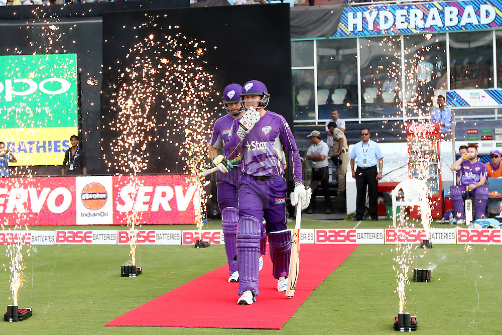Opening batsmen Ben Dunk and Dona Michael walking out onto the field during the first semi final match of the Oppo Champions League Twenty20 between the Kolkata Knight Riders and the Hobart Hurricanes held at the Rajiv Gandhi Cricket Stadium, Hyderabad, India on the 2nd October 2014. Photo by:  Jacques Rossouw / Sportzpics/ CLT20<br /> <br /> <br /> Image use is subject to the terms and conditions as laid out by the BCCI/ CLT20.  The terms and conditions can be downloaded here:<br /> <br /> http://sportzpics.photoshelter.com/gallery/CLT20-Image-Terms-and-Conditions-2014/G0000IfNJn535VPU/C0000QhhKadWcjYs