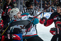 KELOWNA, CANADA - MARCH 14:   Jackson Leppard #8 of the Prince George Cougars checks Erik Gardiner #12 of the Kelowna Rockets into the boards in front of the vistor bench during third period on March 14, 2018 at Prospera Place in Kelowna, British Columbia, Canada.  (Photo by Marissa Baecker/Shoot the Breeze)  *** Local Caption ***